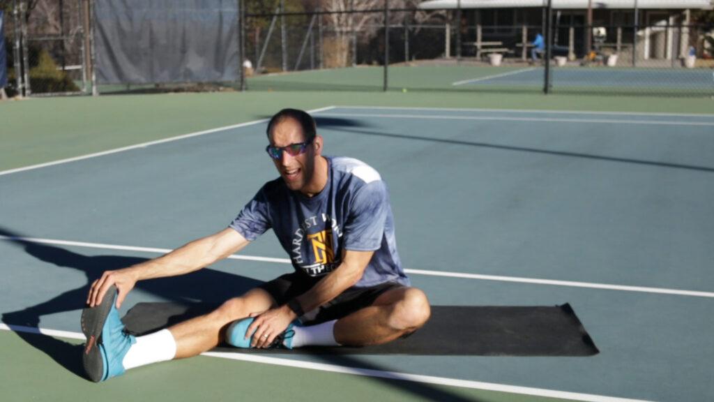Sitting hamstring tennis stretch